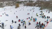 snowboard : aerial of snowboarders, skiers and mountain bikers having rest on top of snow hill. extreme sports, winter activities, healthy lifestyle