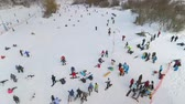 snowboard : aerial of snowboarders, skiers and mountain bikers having rest on top of the slope. winter sports, leisure activities, healthy lifestyle