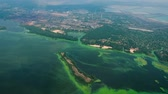 slime : aerial of water polluted with green algae near industrial zone. ecology, waste water, environmental problems