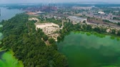 zona industrial : aerial of river polluted with green algae near big industry zone. ecology, waste water, environmental problems Archivo de Video