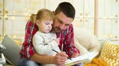 ceruza : young father teaches toddler daughter to draw
