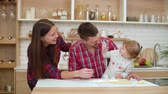 receitas : happy family having fun together in kitchen