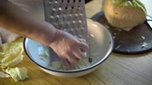 couve : Closeup of senior woman hands grating cabbage