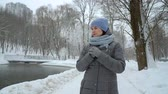 myśl : adult woman walking alone in winter park on snowy day Wideo
