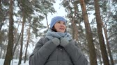 eşarp : smiling adult woman walking in winter park Stok Video