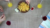 towel : top view of family eating pizza and fries