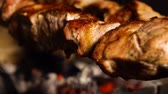grill marinade : closeup of roasting meat on charcoal grill Stock Footage