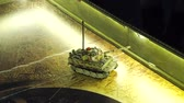 housenka : scale model miltary tank with camouflage moving on play board