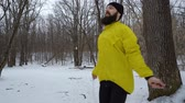 ロープ : bearded sporty man jumping with skipping rope in winter forest 動画素材