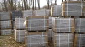 grundriss : many stacks of paving stones wrapped in film are stored on ground outdoors Videos
