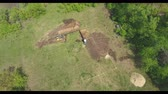 earthmover : aerial of two excavators doing earth works on digging house foundation pit