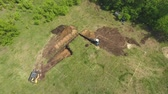 earthmover : aerial of excavator and mini loader digging foundation pit for new house Videos