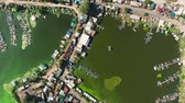 szennyeződés : aerial top down of river banks in fisherman village with green algae in water