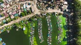 rebut : aerial top down of fisherman village with green algae pollution in harbor water