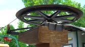 엘리베이터 : big metal wheel of cableway rotating horizontally in city park in summer