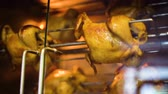 forno : closeup of whole chicken rotate slowly in rotisserie grill