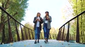 jovial : Fashion bloggers walking on bridge