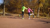 bíblico : Athletic couple stretching legs on sports ground in pair on sunny day