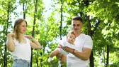 Happy young family with baby girl spending summer time in garden