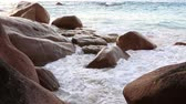 Сейшельские : Waves breaking on granite boulders in beach of Anse Lazio. Island of Praslin in Seychelles.