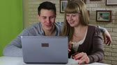 shopaholic : Funny emotional couple to shop online and pay by credit plastic card. Stock Footage