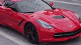 red center : Dubai, UAE - April 09, 2018: Chevrolet Corvette sports car in the new beach and entertainment space La Mer opens to Dubai public stock footage video