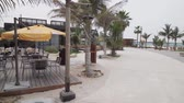banhos de sol : Dubai, UAE - April 09, 2018: New beach and entertainment space La Mer opens to Dubai public stock footage video Vídeos
