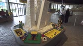 theme : Dubai, UAE - April 01, 2018: Game table for children in exhibition from Lego pieces in Miniland Legoland at Dubai Parks and Resorts stock footage video Stock Footage