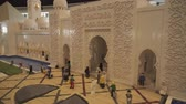 wesołe miasteczko : Dubai, UAE - April 01, 2018: Exhibition of mock-ups Sheikh Zayed Grand Mosque made of Lego pieces in Miniland Legoland at Dubai Parks and Resorts stock footage video