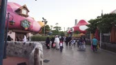 rollercoaster : Dubai, UAE - April 01, 2018: Territory of the amusement Smurfs Village in Motiongate at Dubai Parks and Resorts stock footage video