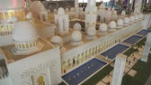 Дания : Dubai, UAE - April 01, 2018: Exhibition of mock-ups Sheikh Zayed Grand Mosque made of Lego pieces in Miniland Legoland at Dubai Parks and Resorts stock footage video