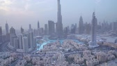 háztetők : Dubai, UAE - April 07, 2018: Burj Khalifa evening view from the height of a skyscraper stock footage video
