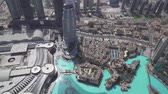 tetőtéri : Dubai, UAE - April 09, 2018: Modern architecture Downtown Dubai and Burj Khalifa Lake at the foot of the tallest building in the world stock footage video