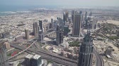 arab : Dubai, UAE - April 09, 2018: Modern urban multi-level road junctions in Downtown Dubai view from the top stock footage video