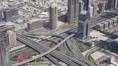 залив : Dubai, UAE - April 09, 2018: Modern urban multi-level road junctions in Downtown Dubai view from the top stock footage video