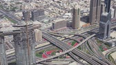 construction roads : Dubai, UAE - April 09, 2018: Modern urban multi-level road junctions in Downtown Dubai view from the top stock footage video