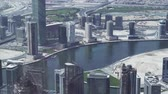 dubaj : Dubai, UAE - April 09, 2018: Modern skyscrapers in the area of the water channel Dubai Creek in Downtown stock footage video