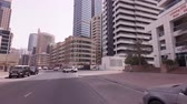 Dubai, UAE - April 08, 2018: Journey on the roads among the skyscrapers of the fashionable district Dubai Marina stock footage video