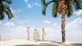 portrait shot : Four Arab men are talking on the beach with palm trees. Stock Footage