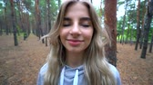 Beautiful  girl went into the woods for mushrooms. Wild nature. Stok Video