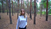 Beautiful girl walk in the forest. The girl went into the woods for mushrooms. Wild nature.