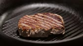 frypan : Closeup of grilled steak on the grill pan