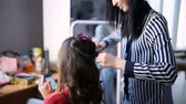 atraente : Professional hairdresser doing hairstyle with bun and curls for beautiful healthy hair