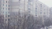 snowfall : romantic snow fall scenery in urban cityscape environment. cold weather season. 4k