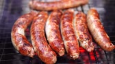 pork meat : Raw sausage Grilled on the picnic flaming grill outdoor Stock Footage