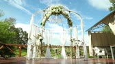 beloved : wedding arch for wedding of newlyweds in the Park Stock Footage