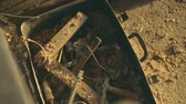 atrás : Ancient tools discovered in a suitcase boy. Slow motion. Stock Footage
