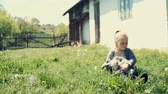 ling : Little girl holding the small goatling. RAW video record. Stock Footage