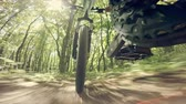 ��innost : Mountain bike POV riding through a forest. Wide angle.