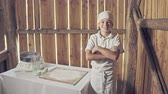 açıklık : Little boy in apron after making bread in the small wood house